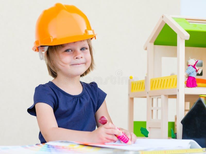 Lack-Rolle mit Lackproben Haus im Bau lizenzfreie stockfotos