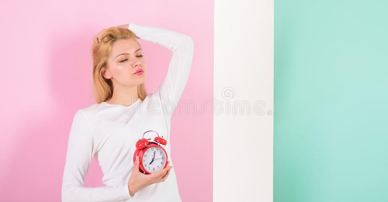 Lack of sleep bad for your health. Oversleeping side effects is too much sleep harmful. Girl drowsy face just woke up royalty free stock photography