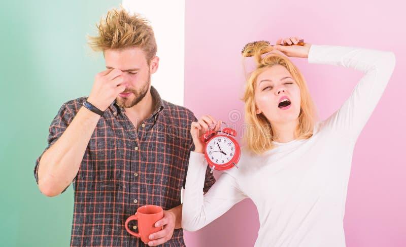 Lack of sleep. Couple sleep not enough time. Family drink morning coffee yawning faces. Couple oversleep awakening hold stock images