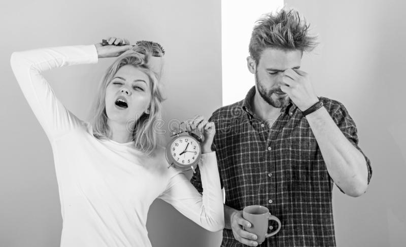 Lack of sleep. Couple sleep not enough time. Family drink morning coffee yawning faces. Couple oversleep awakening hold stock photography