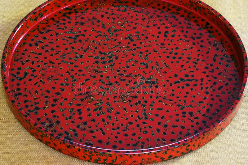 Lacquered tray. Japanese traditional crafts `Tsugaru lacquering` / Lacquered tray royalty free stock photo