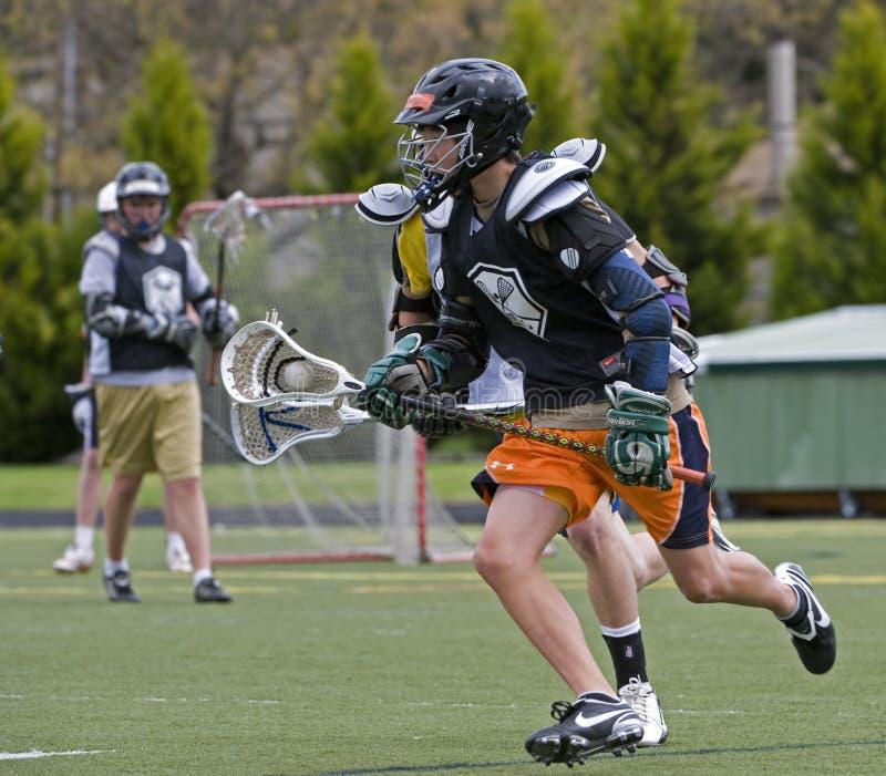 Lacrosse 12-13 van de Jeugd van jongens stock afbeeldingen