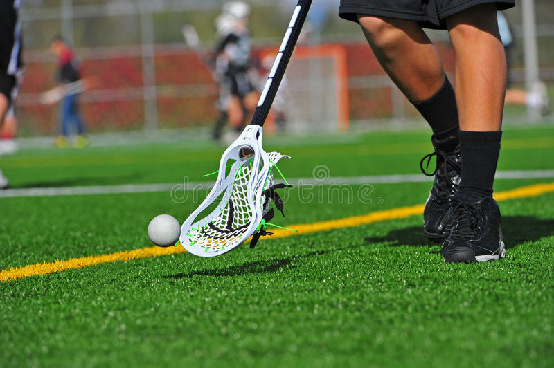 Lacrosse ball catching stock photos