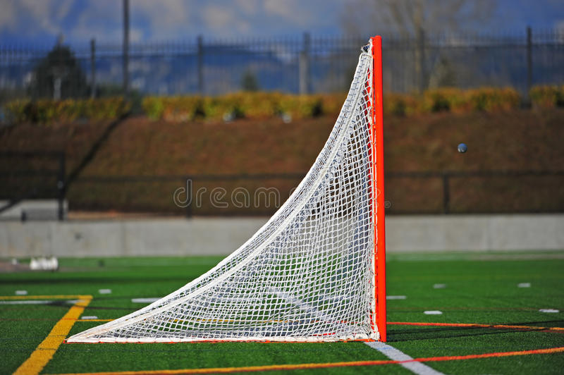 Lacrosse ball going into the goal stock image