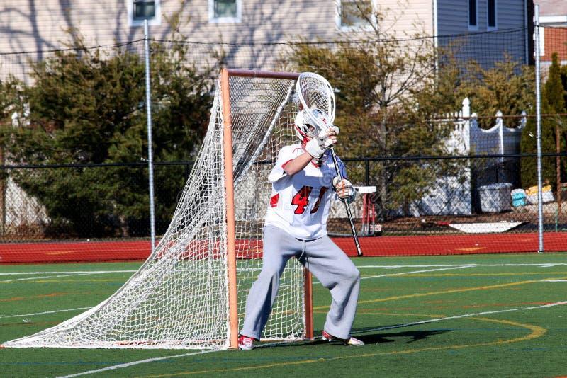 Lacrosse bramkarz przygotowywający robić save zdjęcie royalty free