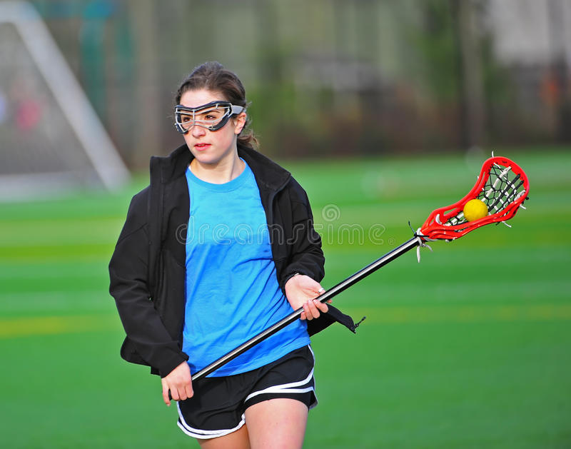 Lacrosse girl cradling ball royalty free stock images