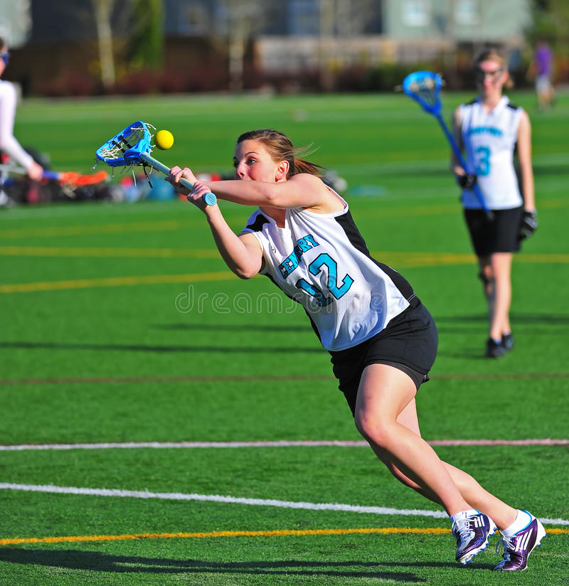 Lacrosse girls eye on the ball stock images