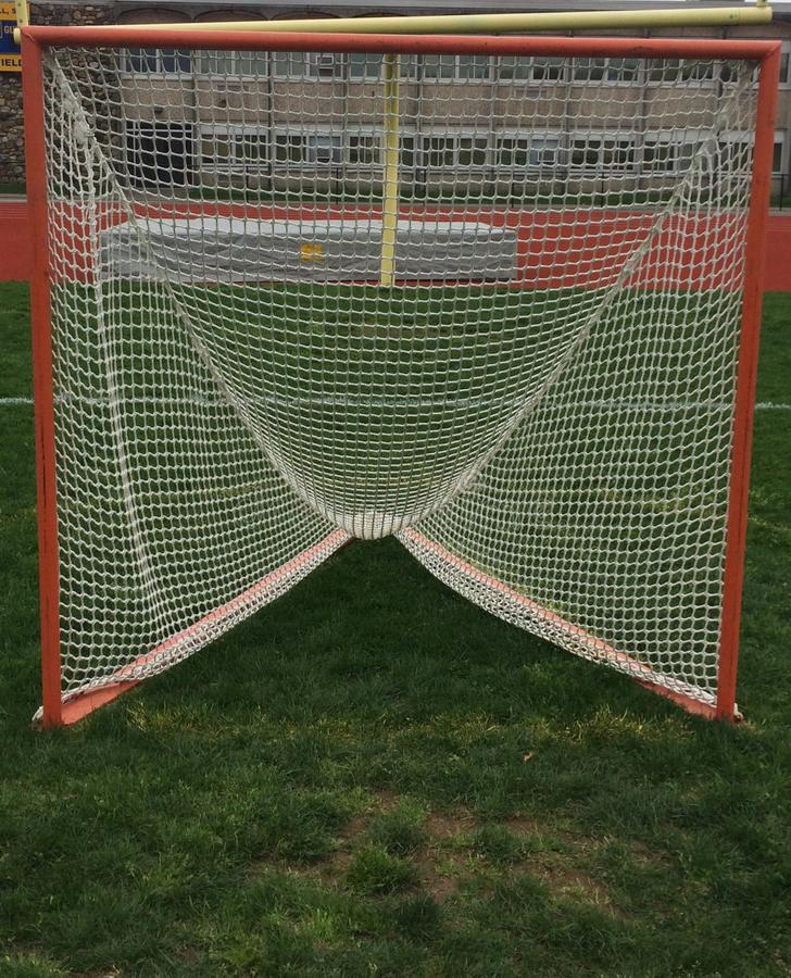 Lacrosse goal on a grass field before a game. stock photography