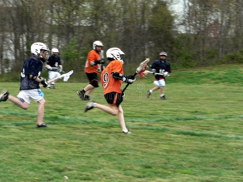 Lacrosse - little league game. A Little League game of Lacrosse being played. All identifying marks have been removed royalty free stock image