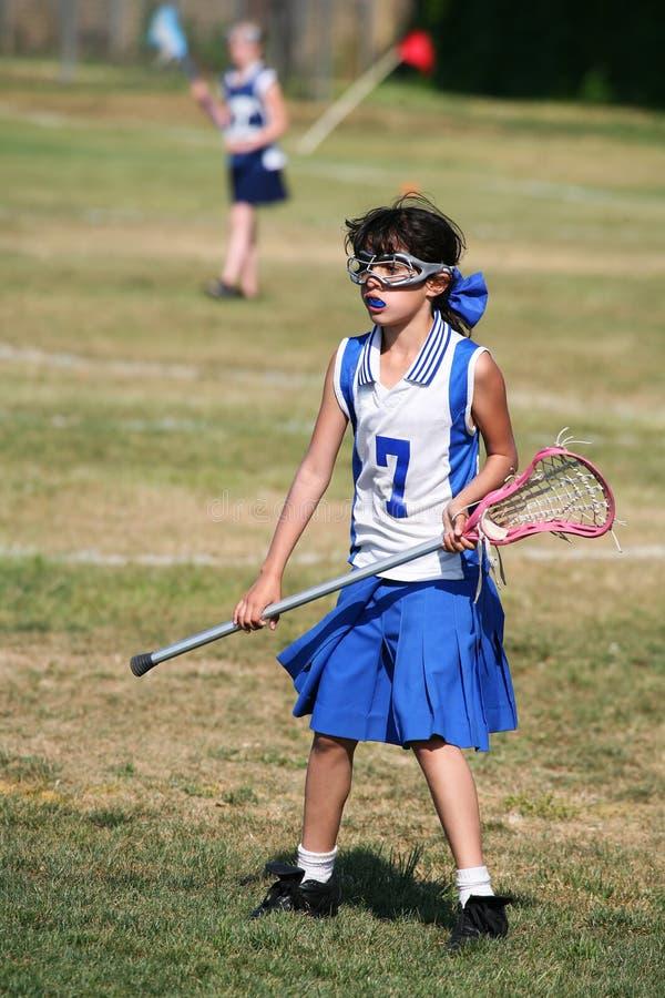 Lacrosse-Mädchen lizenzfreie stockfotografie