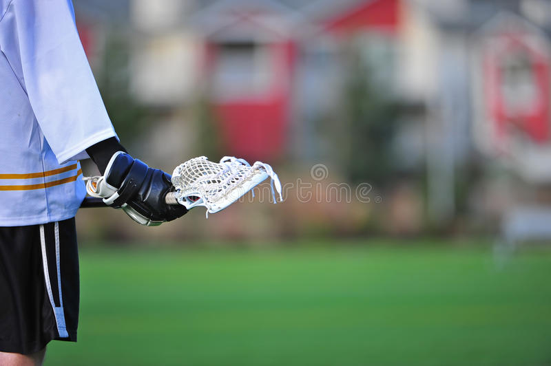 Lacrosse player waiting for action stock photography