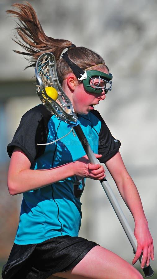 Lacrosse-Spielerbetrieb der Frauen stockfotografie
