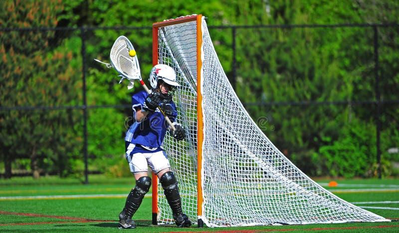 Lacrosse Youth girls goalie stock photography