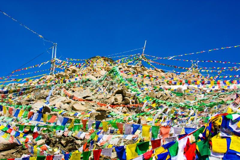 Khardungla pass covered by Buddhist prayer flags stock photography