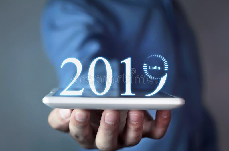 Ladda ett nytt år av 2019 arkivbild