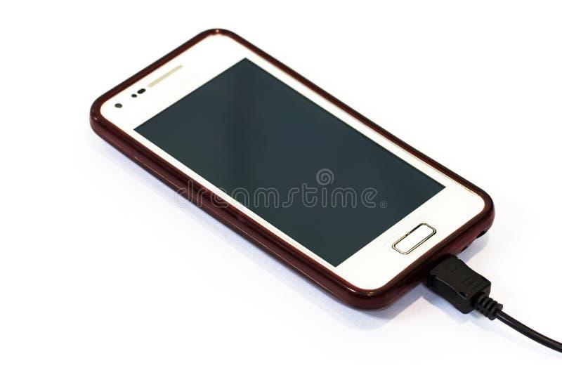 Laddande mobiltelefon royaltyfri bild