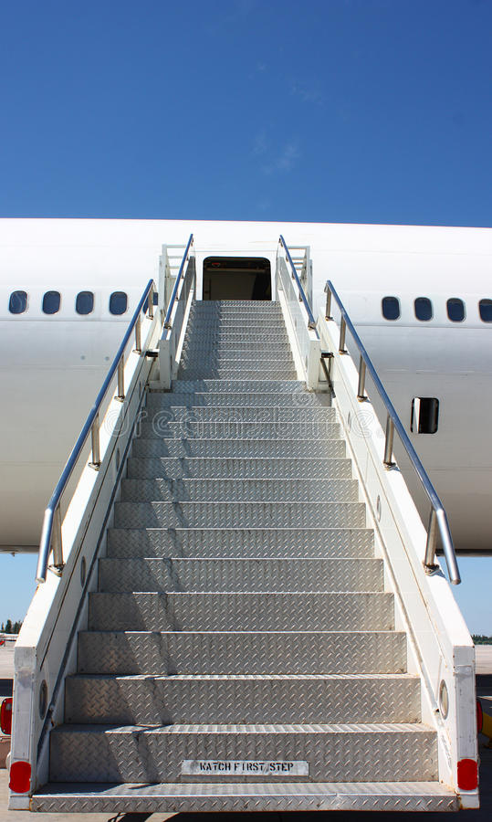 Ladder. An airplane ladder on a clear blue sky background stock photos