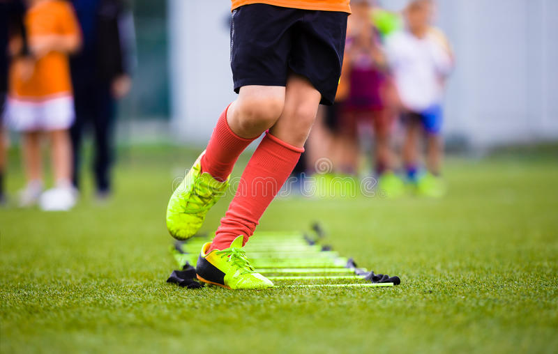 Ladder Drills Exercises for Football Soccer Team. Young Player Practice stock photo