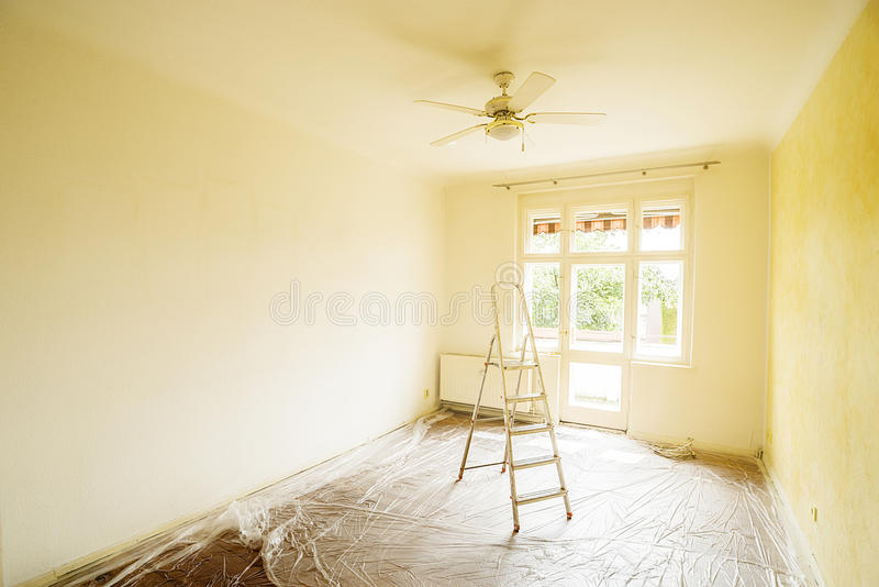 Ladder in empty room stock photo