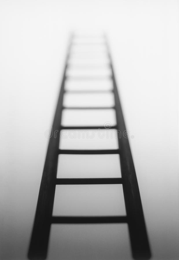 Ladder leading to light source royalty free stock photo