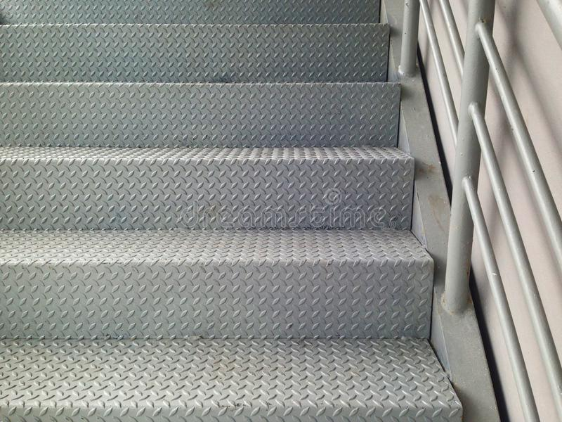 Ladder made of checker plate to increase strength and prevent slipping. royalty free stock photography
