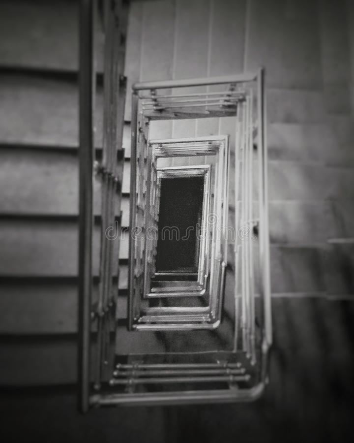 Ladder and stairs going into nowhere dark stock photos