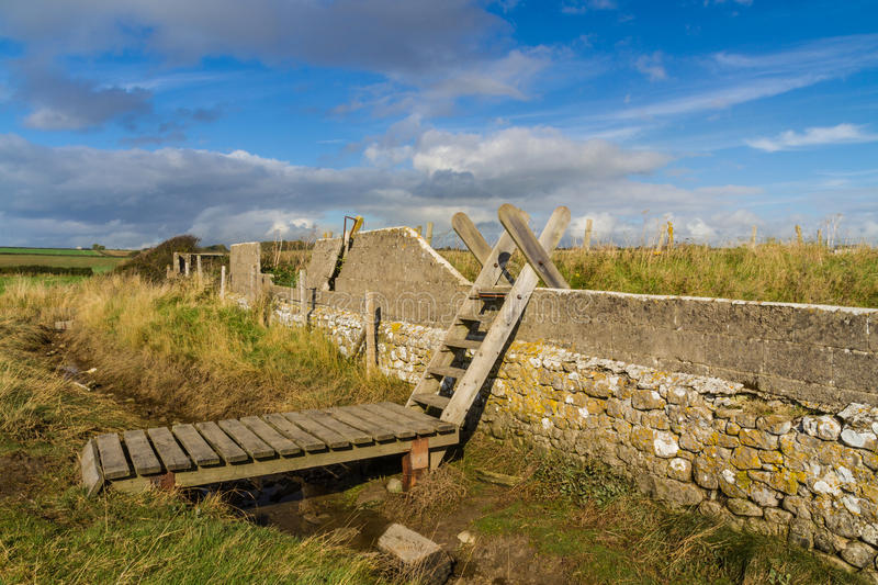 Ladder Stile, South Wales. Typical ladder stile, over wall, with bridge over ditch. Aberthaw beach, South Wales, United Kingdom, Europe royalty free stock photography