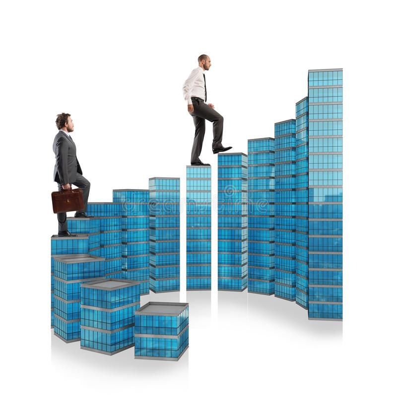 The ladder of success. Business people climb the ladder of success stock photography