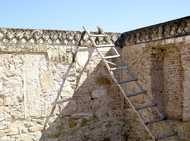 Ladder at the wall. A ladder at an ancient construction site stock photography