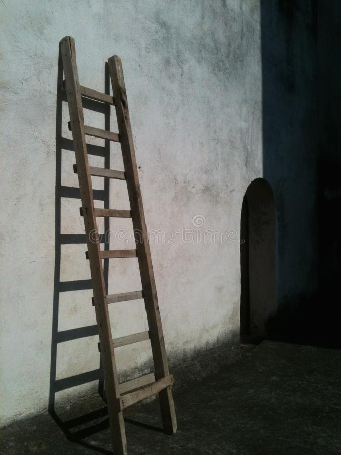 Ladder in the wall royalty free stock photography