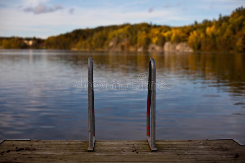 Ladder into water royalty free stock photography