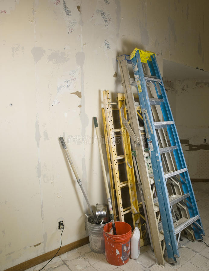 Ladders and scafold against wall during renovation royalty free stock images