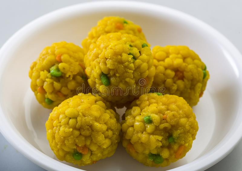 Laddu or laddoo are ball-shaped sweets popular in the Indian subcontinent. stock photography
