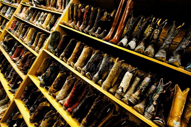 Ladies' cowboy boots line the shelves, Austin, TX stock image