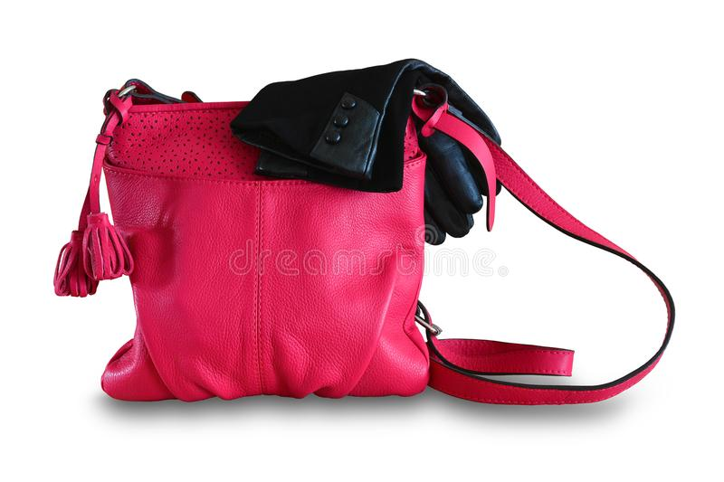 Ladies handbag and gloves. Women`s summer leather bag of fuchsin. E, magents color and black gloves. Isolated, white background royalty free stock photos
