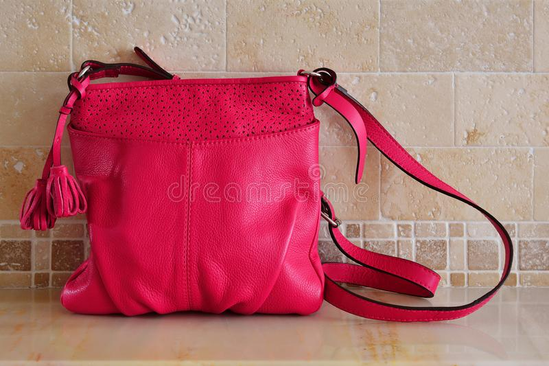Ladies handbag. Women`s summer leather bag of fuchsine, magents. Color royalty free stock image