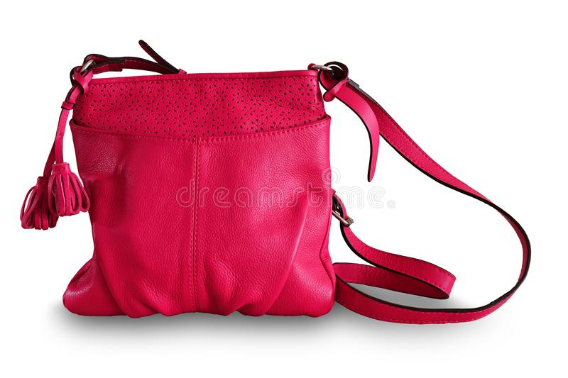 Ladies handbag. Women`s summer leather bag of fuchsine, magents. Color. Isolated, white background royalty free stock images