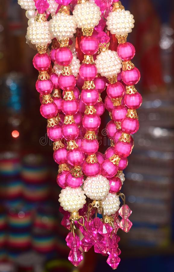 Ladies Ornaments Colourful Object Photograph. The beautiful ladies ornaments with multiple colours and combination of different shape objects background royalty free stock image