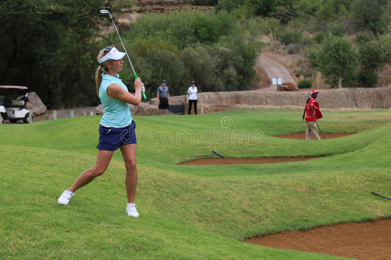 Ladies pro golfer Daniella Montgomery playing over a bunker on N royalty free stock photography