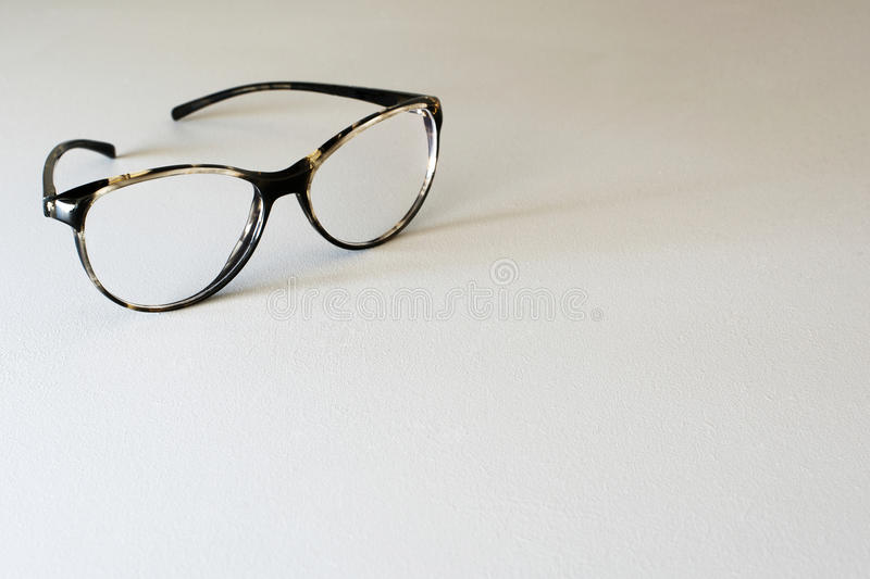 Ladies reading glasses. Spectacles on a pale grey background , horizontal layout, copy space stock photos