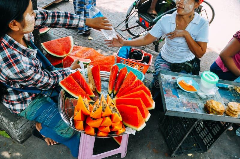 Ladies selling watermelons in Yangon. stock photo