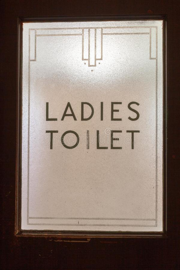 Ladies toilet sign on door glass in art deco style. As seen in a pub on an Australian road trip stock image