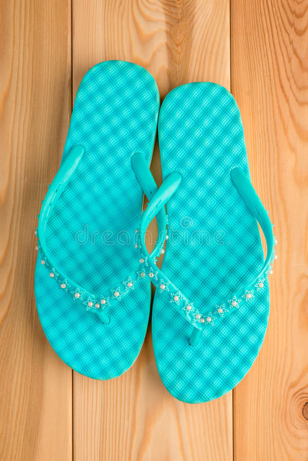 bdf3291da Ladies turquoise flip flops on the wooden floor royalty free stock photos