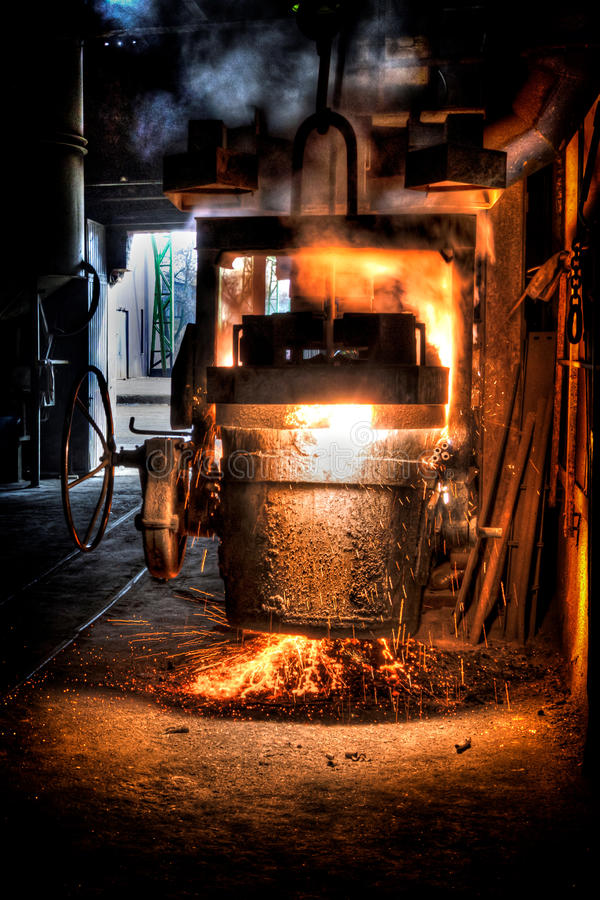 Ladle of molten steel. In a iron foundry royalty free stock photography