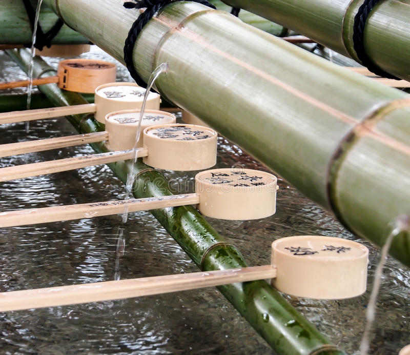 Ladles For Purification With Bamboo Fountain Stock Images