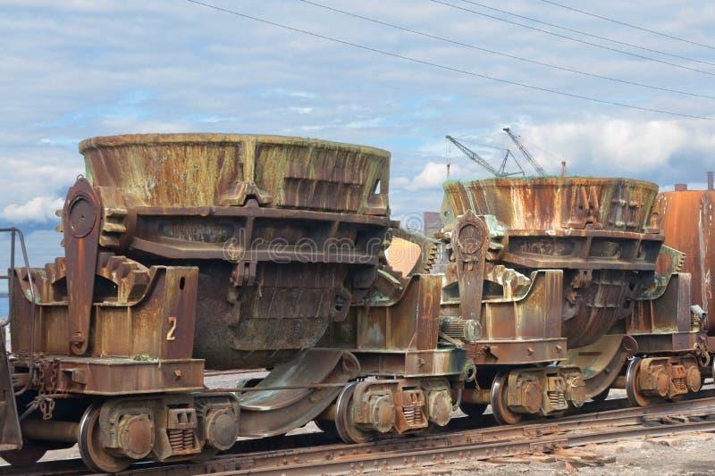 Ladles on a railway platform royalty free stock image