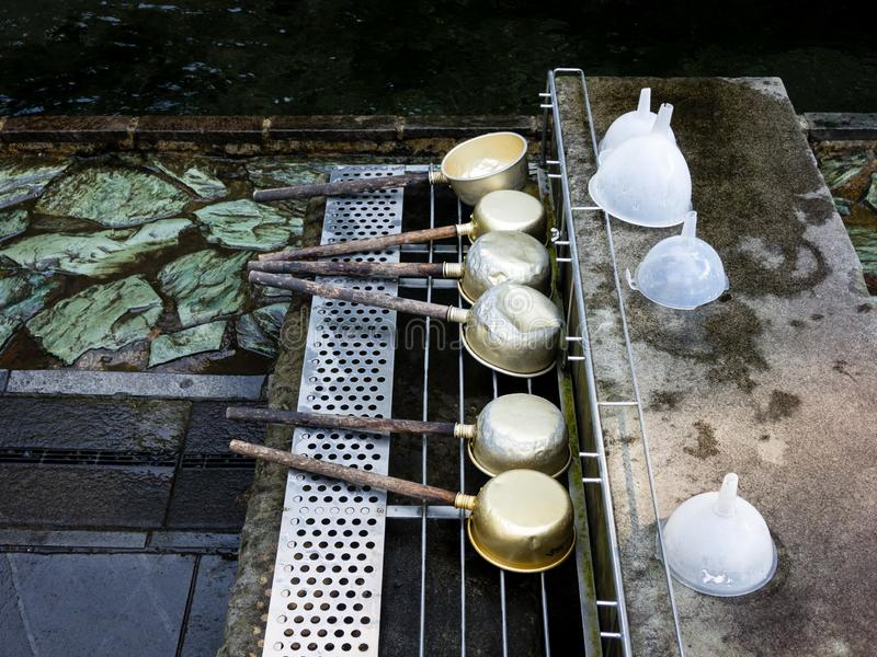 Ladles for scooping water at Shirakawa Springs, Japan royalty free stock photo