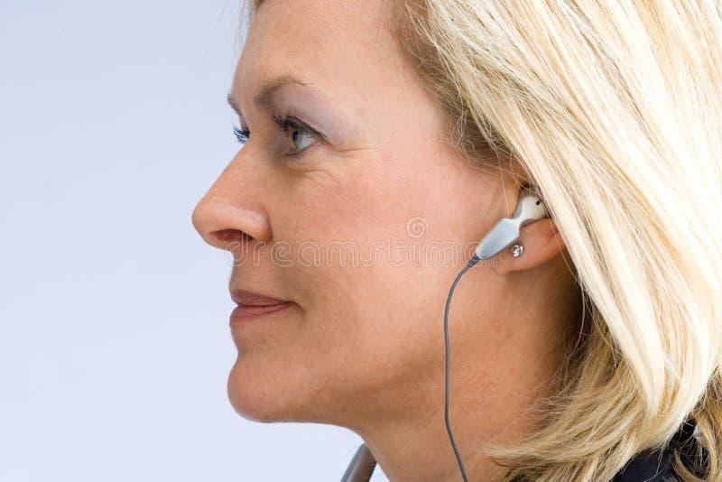 Lado-face da mulher fotografia de stock royalty free