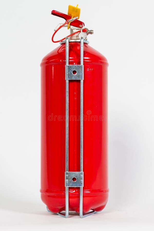 Lado trasero del tanque rojo químico del extintor aislado en wh imagenes de archivo