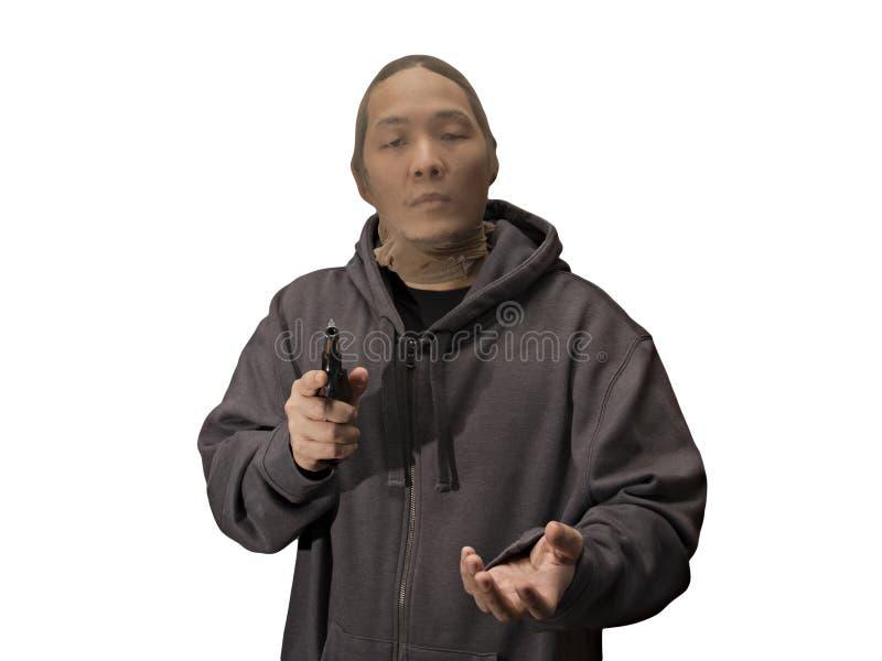 Ladrão com a meia sobre sua arma guardando principal foto de stock royalty free